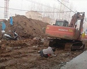 Chinese woman  crushed to death by a digger driver | Photo credit: DailyMail UK