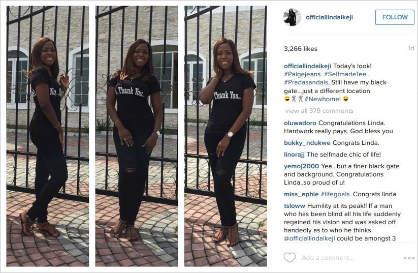 Linda Ikeji standing right at the entrance gate to her newly acquired $2million+ mansion | Constative.com