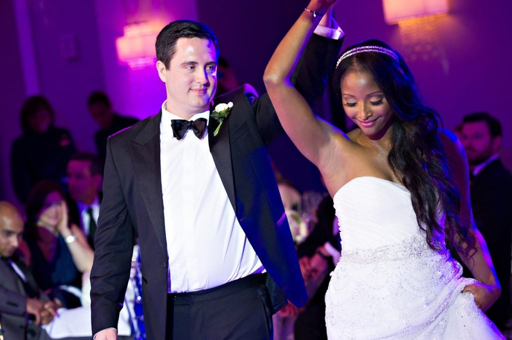 Isha Sesay and Leif Coorlem walking down the Isle in a lavish wedding | Photo credit: HuffPost