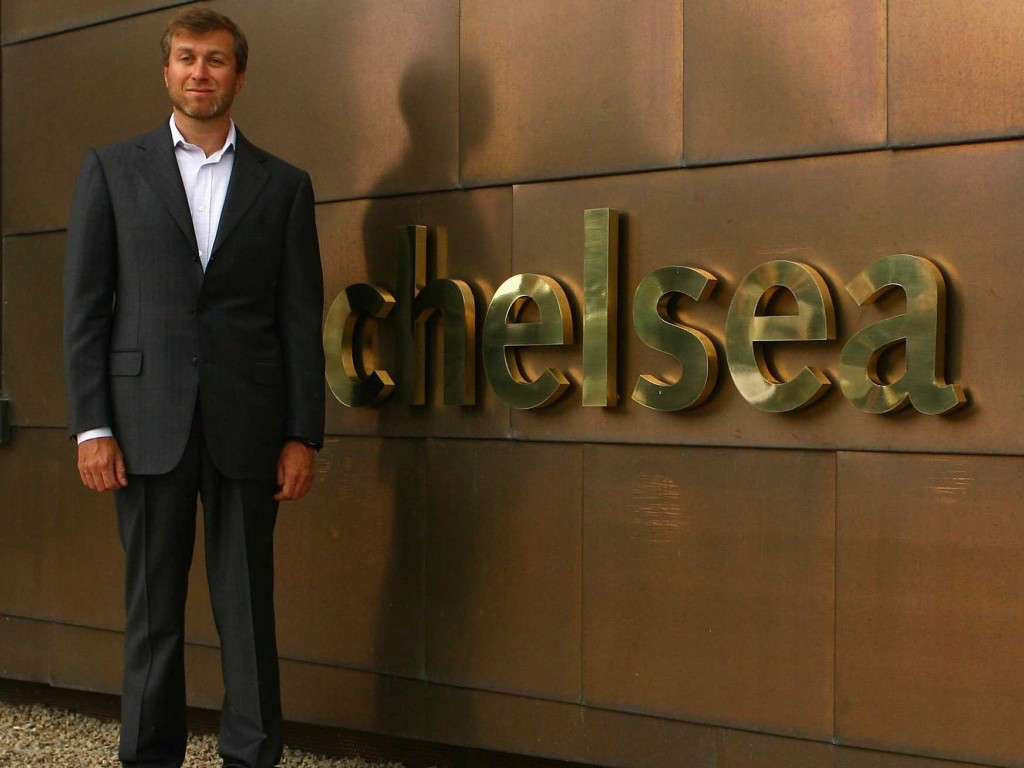 Roman Abramovich standing next to one of his most priced procession, Chelsea emblem. His net worth is $9.1billion | Photo credit: SportsKeeda