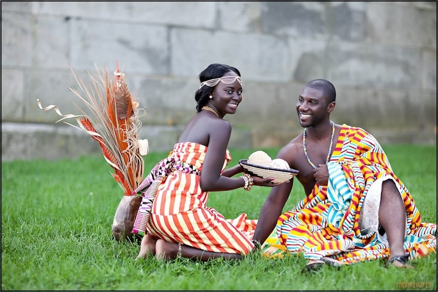A newly traditionally wedded couple in Ghana having their first meals together | Photo credit: africanfashionwear.it