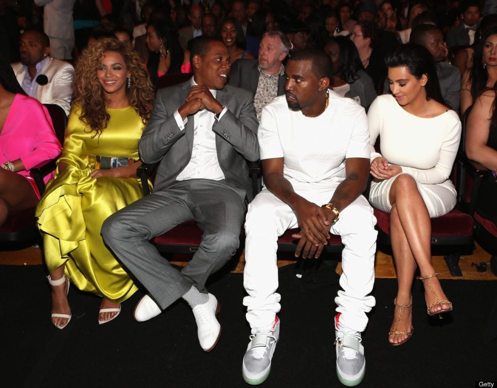 Beyonce, Jay Z, Kanye West, and Kim Kardashian sitting together in an event