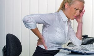 Woman suffering back pain symptoms