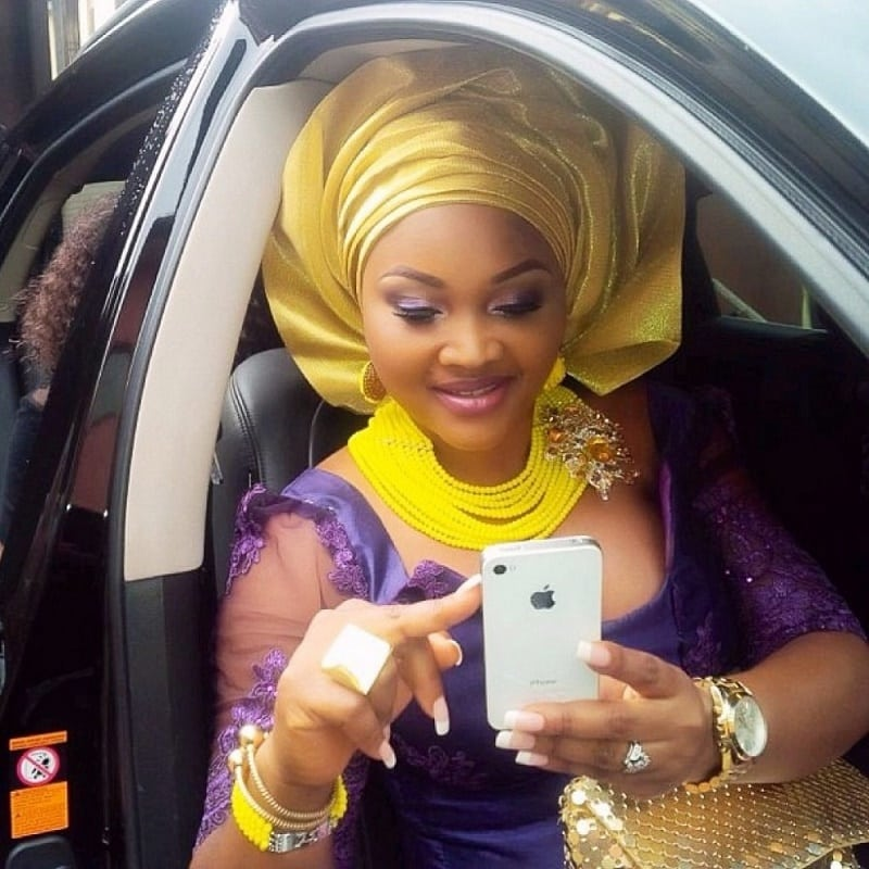Mercy Aigbe inside one of her cars