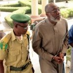 PDP spokesperson Olisa Metuh handcuffs to court