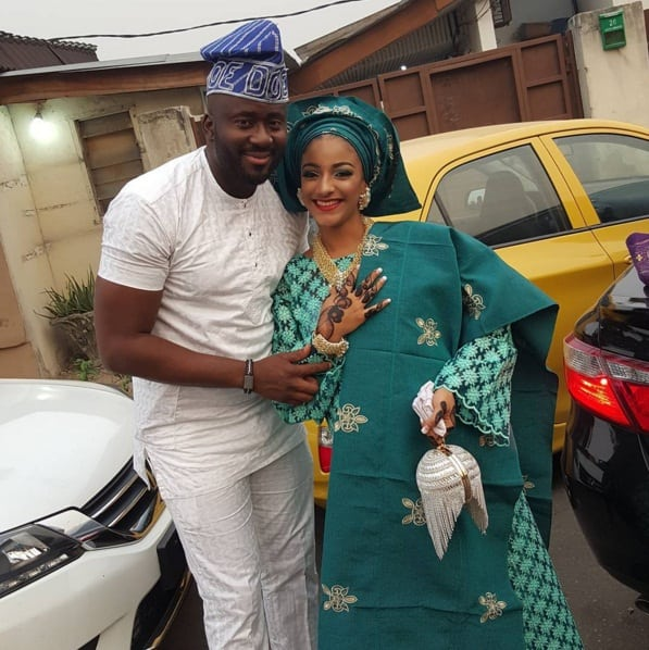 Desmond Elliot and Sophie wearing her traditional wedding attire
