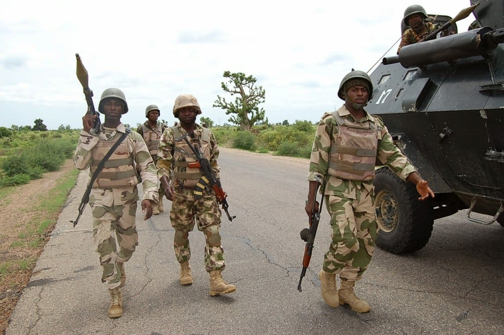 Troops patrolling Damboa after clearing the town of insurgents