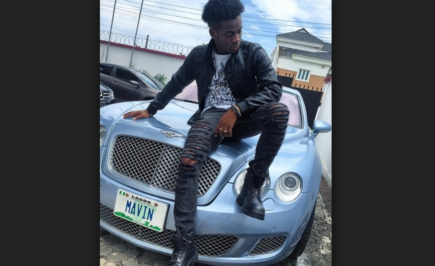 Korede Bello poses with his car