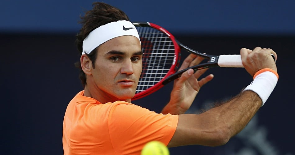Roger Federer in action against Borna Coric