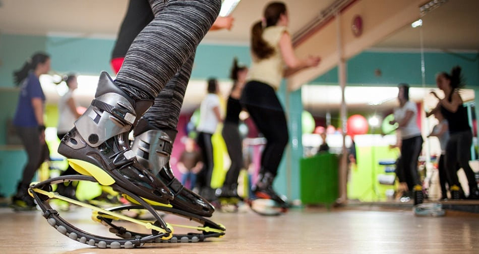 group of people doing exercises with kangoo shoes