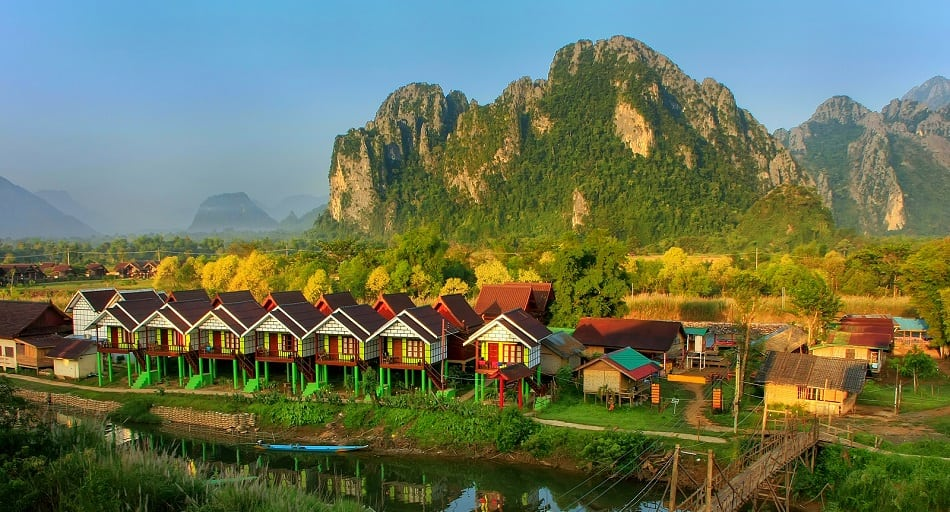 Row of tourist bungalows along Nam Song River